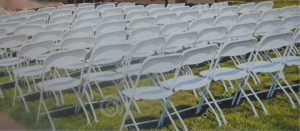Empty chairs for Claude's funeral 's family and guests by Jennie Helderman
